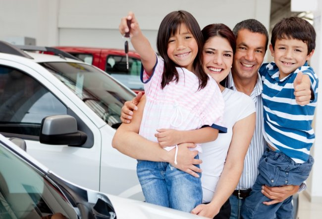 Family picking up their rental car