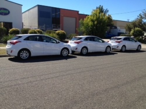A line-up of Hyundai i-30s outside Aussie Bargain
